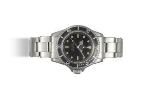 LOT 154. ROLEX, STEEL SUBMARINER WITH POINTED CROWN GUARDS AND GILT DIAL, REF. 5512, C. 1961